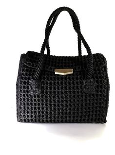 An elegant, luxury, minimal tote bag, to have with you all the necessary things through the day. The bag is handmade, Easy to wear, on all occasions from the morning until the evening. A chic, beautiful tote bag that you can have in your wardrobe. Crocheted handles. Fully lined with quality