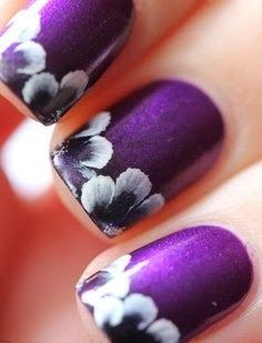 Purple polish with Hawaiian style flowers on the tips.  So pretty! #nailart
