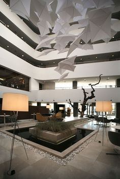 Radisson Hotel Lobby by Tanju Özelgin: water feature, repetition, ceiling element
