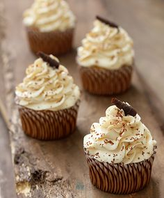 """Tres Leches Cupcakes ~ Dunk it, pump it or drizzle it. Whatever method you use to infuse your Tres Leche Cupcake (""""three milk cupcake) is fine. Just be sure that one of the three milks is coconut milk. Then finish off this dairy-dream cupcake with some dulce de leche buttercream frosting, a little dusting of chocolate shavings, and you'll be peeling away the cupcake wrapper faster than a kid with a...uh, cupcake. Tres Leches Cupcakes Last week I was huffing and puffing about my laziness a..."""