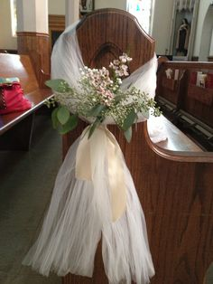 """Pew bows with seeded eucalyptus, pink waxflower and baby's breath. 5"""" of tulle and 24"""" satin ribbon"""