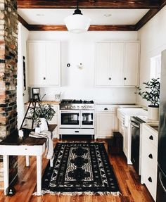 Interesting ceiling framing. I like the color floor. I like the black handles on the kitchen cabinets.
