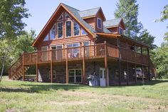 A beautiful Linville with stone lower level and large wrap around deck and porch