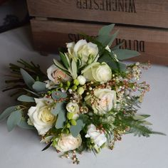 Hand tied winter bridesmaid bouquet of warm whites and creams created by Eden Blooms Florist.  From Vendella Rose, Avalanche, Waxflower, Brunei, Freesia, Lisianthus, Olive, Mrytle, Eucalyptus Poplus & Asparagus Fern.