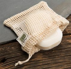 "It's a clever way to use up your bar of soap and all of its pieces. Like a washcloth, reusable bag has a thick, soft weave for scrubbing with an open mesh on the other side. Just put soap into bag and close drawstring. •Makes a great eco-friendly gift (just add soap) •100% natural cotton •Machine washable •Fits most soaps •4""Wx4-1⁄4"" - Line dry.  $5.95"