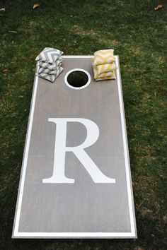 Customized cornhole boards // Photographer: j.woodbery photography // see more: http://theeverylastdetail.com/2013/09/11/fun-and-bright-yellow-and-gray-wedding/