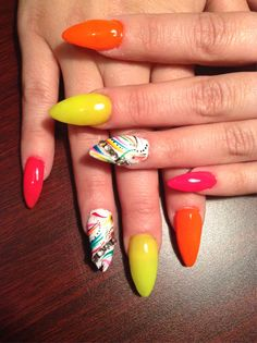 Inspirational photo by Aisha Sequin. Stileto Nails With colorful design and diamonds :) @Bloom.com