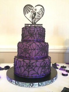 Purple and black sparkly spiderweb Goth Wedding Cake with bats and horror movie . - Purple and black sparkly spiderweb Goth Wedding Cake with bats and horror movie ribbons - Halloween Torte, Halloween Wedding Cakes, Theme Halloween, Purple Halloween, Halloween Decorations, Diy Halloween, Gothic Wedding Cake, Purple Wedding Cakes, Elegant Wedding Cakes