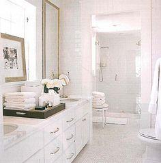 Bright White Bathroom with Walk in Shower. Interior Design: David Jimenez.