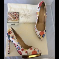 Charlotte Olympia Debbie Multicolor Heel Charlotte Olympia Debbie Heel - In perfect NWT condition and as always, guaranteed authentic! Comes new in Box with dustbag. *Multicolor *Geometric print *5  inch heel *1/2 inch platform *MSRP $895 Charlotte Olympia Shoes Platforms
