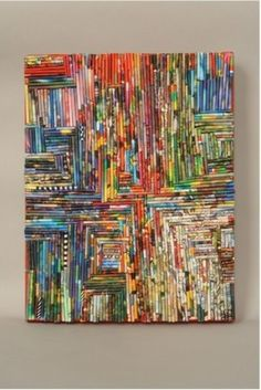 Make a colourful painting with magazine -paperrolls.