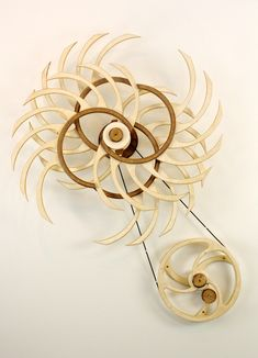 Kinetic Sculpture by David C. Roy - All Sculptures | Wood That Works | Kinetic Art - Aztec