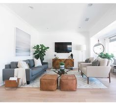 A living room with camel brown, blue, beige, and white is simple way to create a beautiful living room. http://amzn.to/2saZO4H