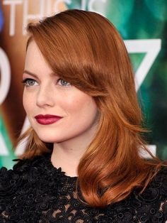 Emma Stone vintage volume hairstyle with classic red lipstick  | allure.com