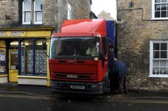This driver was delivering soft drinks in a sleepy village and was searching for a parking space when his lorry became stuck. Thanks to the lane's steep incline, he was unable to reverse back up the street and had no choice but to stay put and endure the taunts of the locals, who found the whole incident much more amusing than his boss.