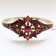Antique Victorian Garnet Bangle - Star with Hearts Design - Beautiful Rose Cut Bohemian Garnets set in Garnet Gold by rubyandjules on Etsy Cuff Bracelets, Bangles, Garnet And Gold, Austro Hungarian, Bohemian Jewellery, Star Flower, Carat Gold, Flower Shape, Beautiful Roses