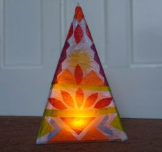 Diwali Lanterns, a tetrahedron made of withies, covered and decorated with tissue paper. Battery powered LED light inside NOT FIRE! Lantern Craft, Lantern Candle Holders, Track Lighting Bedroom, Tissue Paper Lanterns, Battery Powered Led Lights, Diy And Crafts, Paper Crafts, Willow Weaving, Glass Garden