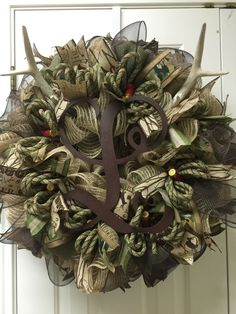 Camo deco mesh wreath with antlers, initial and shotgun shells by Twentycoats Wreath Creations (2015)