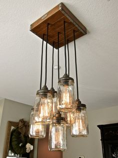 Handcrafted mason jar pendant chandelier, on a rustic vintage style wood crate canopy