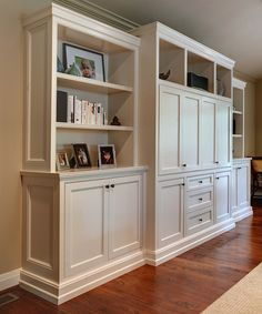 Cabinetry Design - The center portion of the built-in is flat on the front to appear as cabinetry. The flanking components consist of open adjustable shelves, a wood counter-top, decorative end panels, and adjustable shelving for components in lower cabinetry.