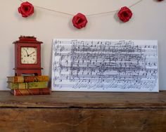 Anniversary Gift. Sheet Music printed on Canvas ... perfection. Use your first dance lyrics. Canvas created by www.Geezees.com {paper flowers by lillesyster @ etsy)