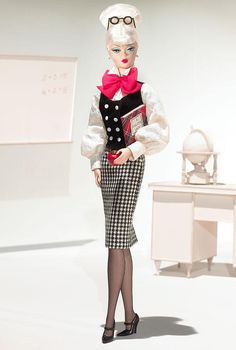 ~ The Teacher Barbie® ~ designed by Robert Best, celebrates the working woman. The ensemble includes tasteful houndstooth skirt, white blouse, and black vest. A red bow tie, black hose and mary janes, and cerebral round glasses