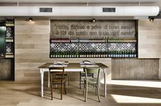 Kook restaurant by Noses Architects.  Love the mix of timber, tiles and etched concrete for this Pizzeria in Rome