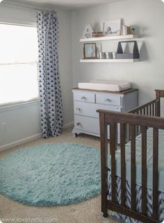 Navy, gray, and mint boy nursery - lots of inexpensive decor and DIY ideas and a great mix of vintage and modern style.