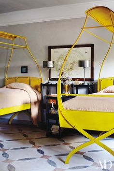The twin steel beds in a guest room add a whimsical touch. See more inspiring and chic twin beds.