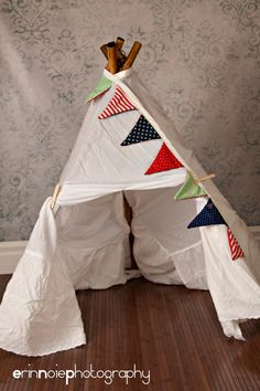 DIY teepee! 5 Bamboo sticks, twin-sized bed skirt, Clothespins, Twine, and Scissors