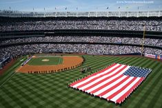New Yankee Stadium | the new yankee stadium on opening day 2009 yankee stadium is a ...    This is as american as it gets,nothing more american then the us flag and the ny yankees to boot.god bless both