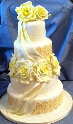 Lace and Lemon Roses Wedding Cake with Edible pearls and lace – sugar drapes and large lemon sugar roses.