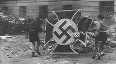 Nazi symbols are banned in Germany under criminal law - these children burn Nazi symbols in post-war Germany.