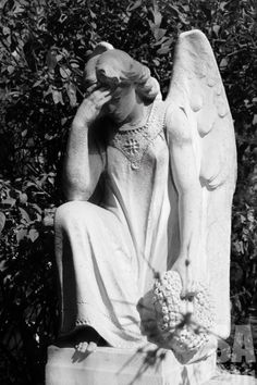 I've never understood the statues of sad angels as memorials.  We are sad that our loved one is gone, the angels rejoice they have another to watch over us.