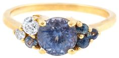 Handmade custom cluster ring with sapphires and diamonds. Shown in yellow gold.