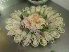 Prawn Caesar mini wraps, with a prawn Caesar salad garnish in the middle