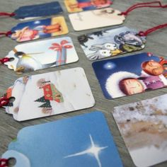 recycle old cards make tags!  We always use the front if the card and tape it to the gift. But you can also put a whole in it a s tie it on.
