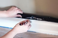 Definitely read this post before you start patching and painting baseboards! This is the easiest method that I have seen! Click through to the post to see how! Painting Baseboards, Painting Trim, Painting Tools, Diy Painting, Modern Staircase, Staircase Design, Narrow Hallway Decorating, Fixer Upper House, Mobile Home Decorating