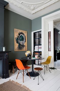 green walls with ornate moldings and oversized art. / sfgirlbybay