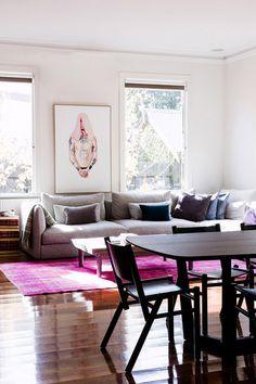 living room, magenta overdyed rug, modern gray, Lauren & David Seeman Melbourne home, via the design files