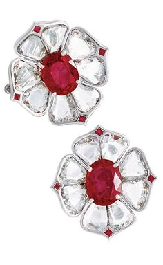 Viren Bhagat floral earrings made of flat petal-shaped diamonds (devoid of facets) with a bright ruby centerpiece.