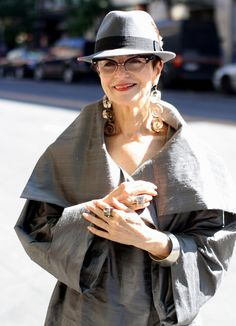 great style. how adorable is that hat with those glasses and statement earrings. It all works together so beautifully
