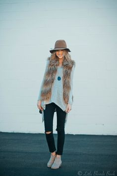 fur vest,jeans. sweater and jeans. mountain comfort. cozy chic. colorado street style.