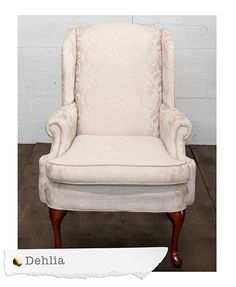 """Our Dehlia Wingback Chairs feature a cream damask inside and a tan linen blend back. Dimensions: 31"""" x 25"""" x 42"""" Quantity: 2"""