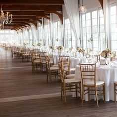 Formal reception space flooded with natural light and chandeliers | Melissa Robotti Photography | Wychmere Beach Club