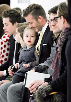 Front row cutie! David Beckham sits with kids Brooklyn, Cruz, Romeo and Harper during Victoria's NY Fashion Week show Feb. 9