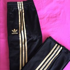 Adidas firebird track pants Adidas firebird track pants in black and gold. Draw string at the hips. Zippers on ankles. Fleece lining. Size in pictures. No tags. Never used. Adidas Pants Track Pants & Joggers