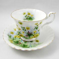 Made by Royal Albert, this tea cup and saucer is white and covered with yellow flowers. The tea cup is in the Montrose shape, and has gold trim. Its part of Royal Alberts Sunnyside Series, pattern is called Susan. Excellent condition (see photos). Markings read: Royal Albert Bone China