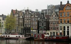 Amsterdam canal with houseboats and historic buildings in the UNESCO designated part of the canal.