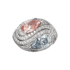 "CARTIER. ""Infinite Motion"" ring - platinum, one 2,18-carat fancy intense pink VS1 pear-shaped diamond and one 2,03-carat fancy intense blue VS2 pear-shaped diamond, brillant-cut diamonds"